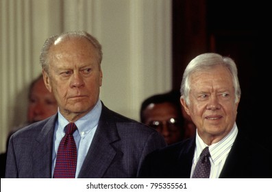 Washington, DC. USA,14th September,1993 Former Presidents Gerald Ford and James Carter look on during the signing in the East Room of the White House of the North American  Free Trade Agreement Treaty