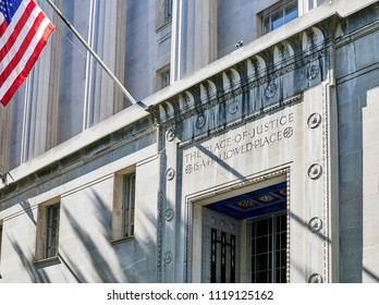 "Washington DC, USA-June 5, 2018: Robert F Kennedy Department of Justice building entrance  ""The Place of Justice is a Hallowed Place"" engraved in stone above the door"