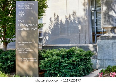 Washington DC, USA-June 5, 2018: Robert F Kennedy Department of Justice building sign with landscaping