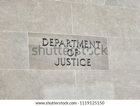 Washington DC, USA-June 5, 2018: Robert F Kennedy Department of Justice building sign on stone wall