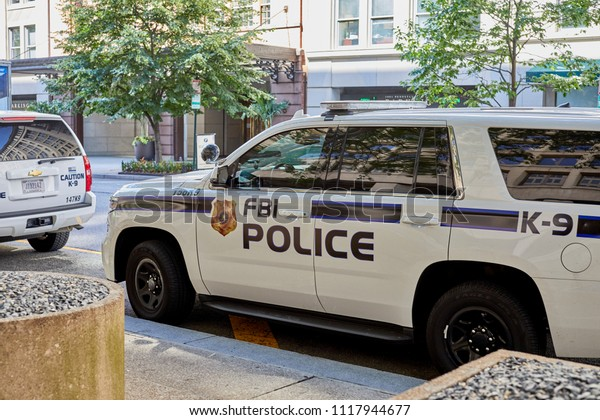 Washington DC, USA-June 5, 2018: FBI K-9 Police cars waiting in line for security check at the J. Edgar Hoover FBI Building