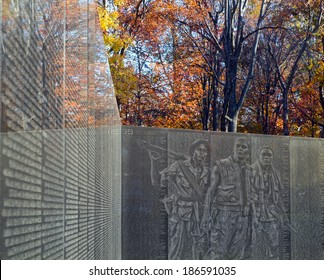 Washington DC - Vietnam Veteran's Memorial with image of three soldiers monument ghosted on the wall.