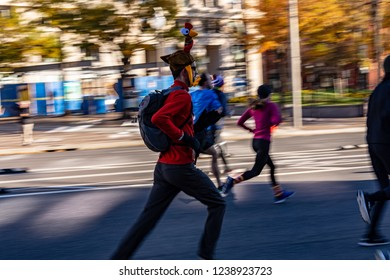 Washington DC,DC/USA- NOV 22 2018 A participant running for  Thanksgiving Day Trot for Hunger, a 5K fun run on Thanksgiving Day in Washington DC.