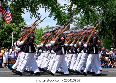 WASHINGTON DC-May 25, 2015: Memorial Day Parade. A marching platoon from the United States Marine Corps wearing blue-white dress uniforms. Close up profile view.