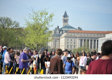 Washington D.C./USA- 04/16/2014:  The Old Post Office building is seen past throngs of tourists visiting the Smithsonian.