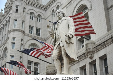 Washington D.C./USA- 04/25/2014: The Benjamin Franklin monument is seen in front of the Old Post office building.