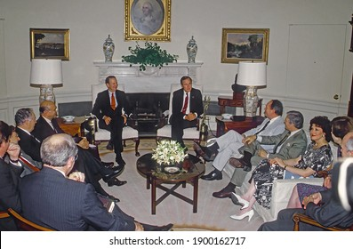 Washington, DC.USA, 1989President George H.W. Bush flanked by Secretary of State James Baker III on the left holds a meeting with his cabinet members in the Oval Office of the White House.