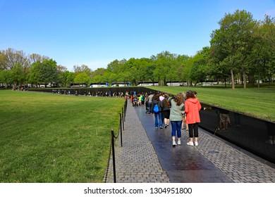 WASHINGTON, DC/USA - APRIL 24, 2017:  The Vietnam Memorial Wall in Washington, DC is a popular tourist attraction.