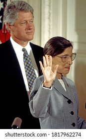 Washington, DC.USA, August 10, 1993 Ruth Bader Ginsberg holds her right hand up as Chief Justice William  H. Rehnquist administers the oath of office and she is sworn in to the Supreme Court