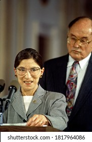 Washington, DC.USA, August 10, 1993 Ruth Bader Ginsburg speaks to reporters in the East Room of the White House as Chief Justice William  H. Rehnquist stands behind her after swearing her in
