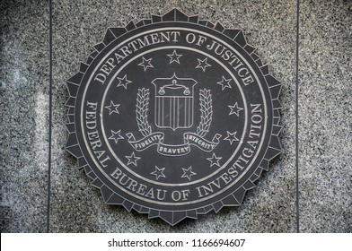 Washington, D.C../USA -- August 10, 2018: The seal of the Federal Bureau of Investigation on the J. Edgar Hoover FBI Building.