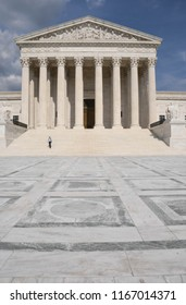 Washington, D.C./USA -- August 10, 2018: A tourist descends the steps of the U.S. Supreme Court building in late afternoon.