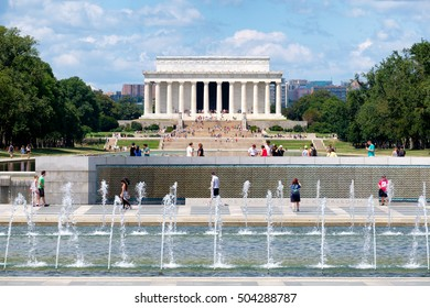 WASHINGTON D.C.,USA - AUGUST 14, 2016 : Tourists at the National Mall in Washington D.C. with a view of the Lincoln Memorial and the World War Two Memorial