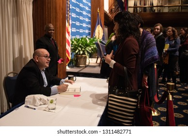 Washington, DC/USA - February 11, 2019: Washington Post Reporter and former prisoner in Iran Jason Rezaian signs copies of his new book PRISONER at the National Press Club