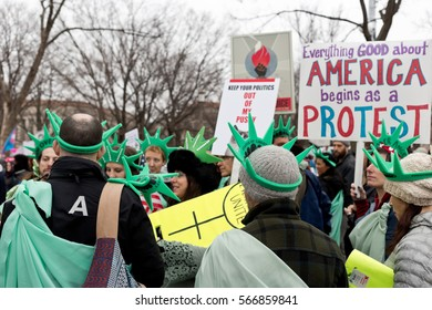 WASHINGTON, DC/USA - JANUARY 21, 2017: Women's March on Washington; an unidentified group of participants hold signs on the National Mall