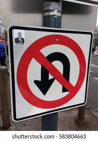 Washington, D.C./USA January 21 2017: Women's March on Washington: Traffic sign vandalized with a political sticker. The sticker has the words, `TAX EVADER` under a photo of President Donald Trump.