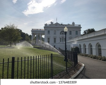 Washington DC,USA - July 14,2017:Water the lawn with a sprinkler in the morning.