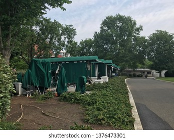 Washington DC,USA - June 03,2017:A place for TV broadcast in the White House seen from the office side. It has a tent for rain protection and is called pebble beach. There is currently no tree with sp