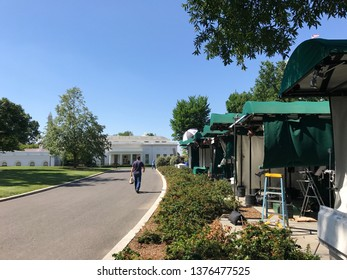 Washington DC,USA - June 21,2017:A place for TV broadcast in the White House seen from the Gate Side. It has a tent for rain protection and is called pebble beach.