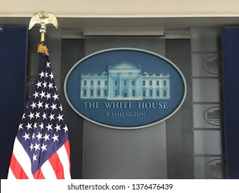 Washington DC,USA - June 21,2017:Stars and stripes at the White House Press Conference Hall and White House insignia.