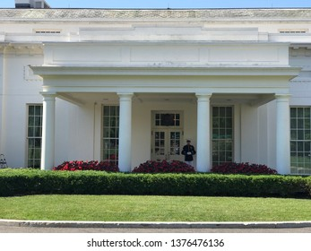 Washington DC,USA - June 21,2017:The north main entrance of the presidential office on the west side of the White House. The president is in office because a guard is standing.
