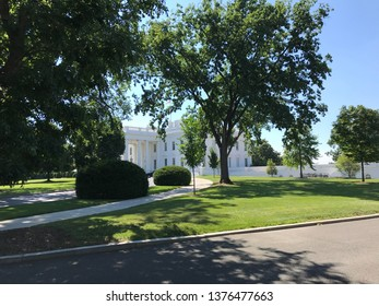Washington DC,USA - June 21,2017:When the white house trees are overgrown as seen from the TV broadcast location, the buildings are not visible so much.