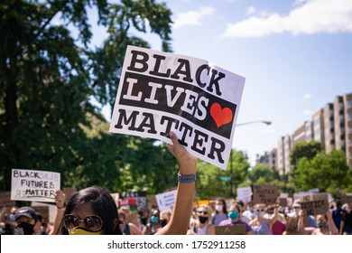 Washington D.C./USA- June 7th 2020: A protester holding a Black Lives Matter sign in Washington D.C.