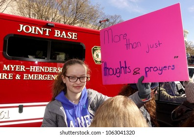 WASHINGTON, DC/USA - MARCH 24, 2018: A female student holds a anti-gun protest sign on Pennsylvania Avenue during The March For Our Lives demonstration in Washington, DC on March 24, 2018.
