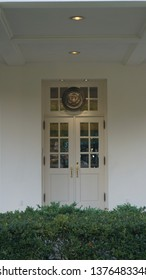 Washington DC,USA - Nov 15,2017:The north main entrance of the presidential office on the west side of the White House. The president's badge is raised above the door.