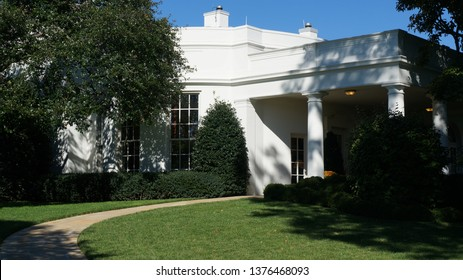 Washington DC,USA - Nov 19,2014:A photo of the Presidential Office (Oval Office) seen from the south on a sunny day. The desk of the president is behind the large glass window.
