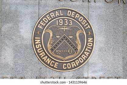 Washington, DC/USA-6/21/19: The official seal of the Federal Deposit Insurance Corporation on the facade of the banking agency's headquarters near the White House.