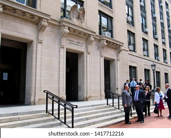 Washington, DC/USA-6/6/19: People stand outside the headquarters of the General Services Administration in Foggy Bottom.