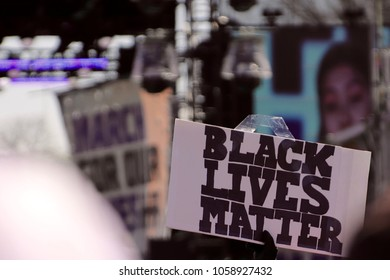 Washington, DC/USA-March 24, 2018: A Black Lives Matter sign at The March For Our Lives demonstration as thousands of students gather on Pennsylvania Avenue in Washington, DC on March 24, 2018
