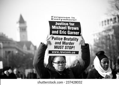 WASHINGTON - DECEMBER 13: Protesters march against police shootings and racism during a rally in  Washington, DC on December 13, 2014