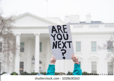 WASHINGTON FEBRUARY 19:  A protester holds a sign protesting gun laws at the White House on February 19, 2018 in Washington DC