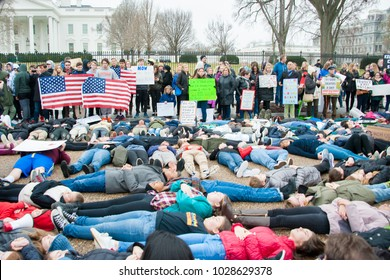 WASHINGTON FEBRUARY 19:  Teenagers stage a lie-in at the White House to protest gun laws on February 19, 2018 in Washington DC