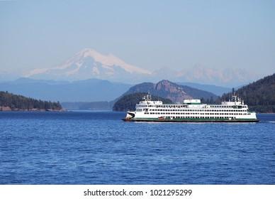 Washington ferry passes through San Juan Islands in front of Mount Baker