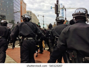 """WASHINGTON, Jan. 20, 2017 -- Police chase #DisruptJ20 marchers during the presidential inauguration of Donald Trump, culminating in a mass arrest of 230 protesters charged with """"felony rioting."""""""