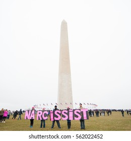 WASHINGTON January 21:  Protesters hold signs at the Women's March on Washington rally in support of women's rights in Washington DC on January 21, 2017, a day after President Trump's inauguration