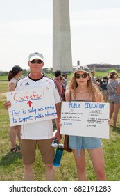 WASHINGTON JULY 22: Demonstrators hold signs at the March for Education to show support for public education and the need for federal funds in Washington DC on July 22, 2017