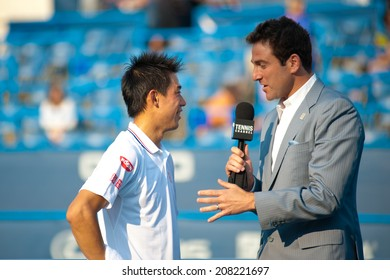 WASHINGTON -  JULY 30: Kei Nishikori (JPN) is interviewed after his win over Sam Querrey (USA, not pictured) at the Citi Open tennis tournament on July 30, 2014 in Washington DC