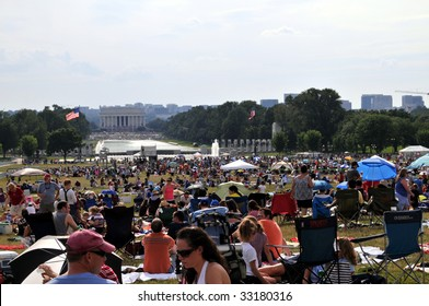 WASHINGTON - JULY 4: People are gathering on the National Mall in Washington DC for Independence Day celebrations on July 4, 2009. The Lincoln Memorial can be seen in the background.