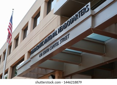 WASHINGTON - JULY 6, 2019: DEMOCRATIC NATIONAL HEADQUARTERS sign at building entrance. The HQ houses the DEMOCRATIC NATIONAL COMMITTEE DNC which governs the Democratic Party