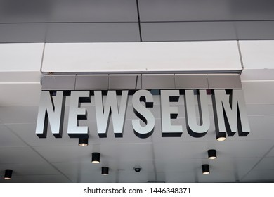 WASHINGTON - JULY 6, 2019: NEWSEUM sign at building entrance. The museum focuses on journalism and First Amendment freedoms
