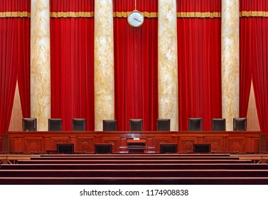WASHINGTON - JUNE 2014:   The court room interior at the United States Supreme Court, showing the seats for the nine judges.