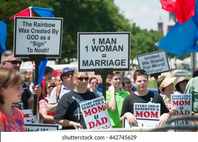 WASHINGTON JUNE 25:  A supporter of same-sex marriage counter protests in front of the U.S. Capitol at the March for Marriage in Washington, DC on June 25, 2016.