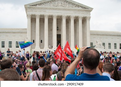 WASHINGTON June 26 - A crowd gathers at the U.S. Supreme opinion  after its ruling legalizing same-sex marriage in all fifty states was  delivered on June 26, 2015