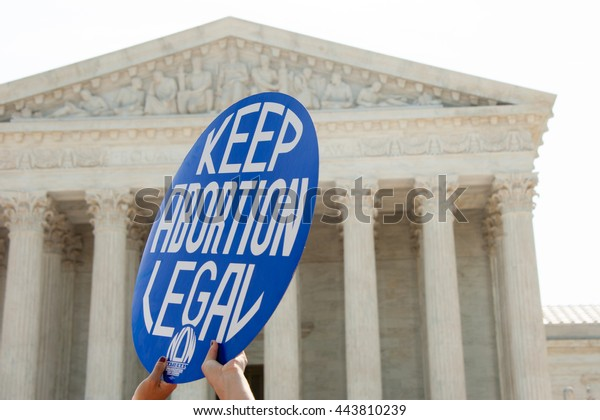 WASHINGTON JUNE 27:  A Pro-choice activist holds a sign in front of the Supreme Court in Washington, DC on June 27, 2016
