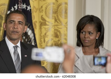 WASHINGTON - JUNE 29: US President Barack Obama with the first lady Michelle Obama next to him gives speech from the East Room of the White House June 29, 2009 in Washington, DC