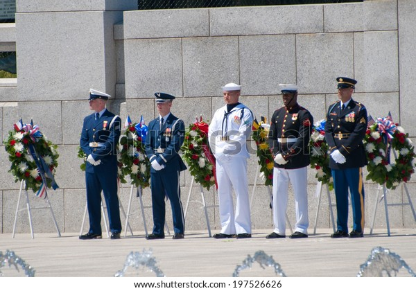 WASHINGTON JUNE 6:  The branches of the military are represented during the ceremony marking the 70th anniversary of DDay at the WWII Memorial June 6, 2014 in Washington, DC